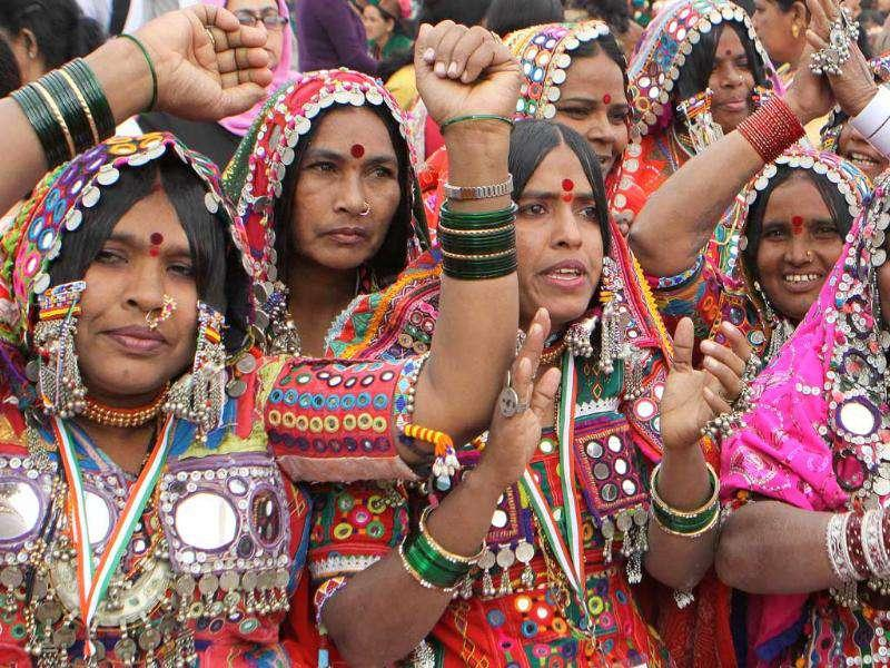 Tribal women dance during the inauguration ceremony of the National Convention on Empowerment to Tribal Women in New Delhi. (HT Photo/Sonu Mehta)