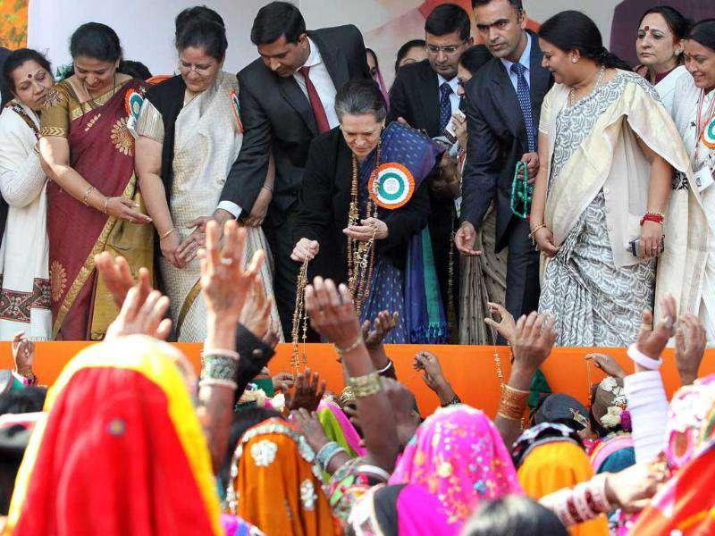 Congress party president Sonia Gandhi greets the tribal women during the inauguration ceremony of the National Convention on Empowerment to Tribal Women in New Delhi. (HT Photo/Sonu Mehta)