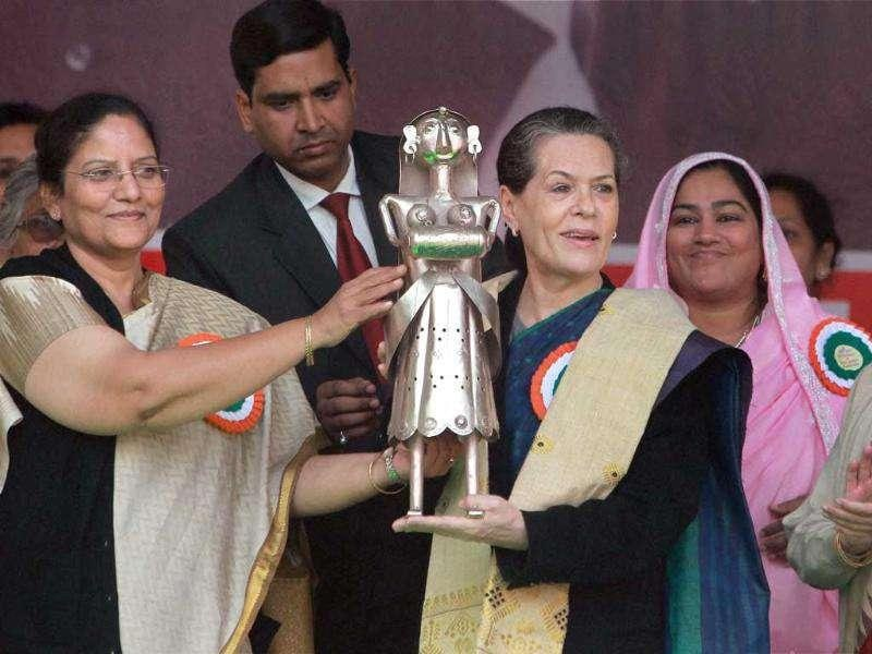 Congress president Sonia Gandhi is presented a memento at the National Convention on Empowerment to Tribal Women at AICC office in New Delhi. (PTI Photo/Manvender Vashist)