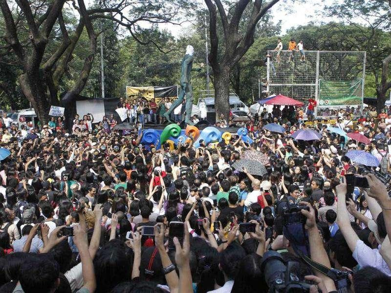 Fraternity members squeeze through a crowd of shrieking students as they run naked along Palma Hall of the University of the Philippines campus in suburban Manila. More than 30 members of the Alpha Phi Omega fraternity ran naked in the annual tradition dubbed