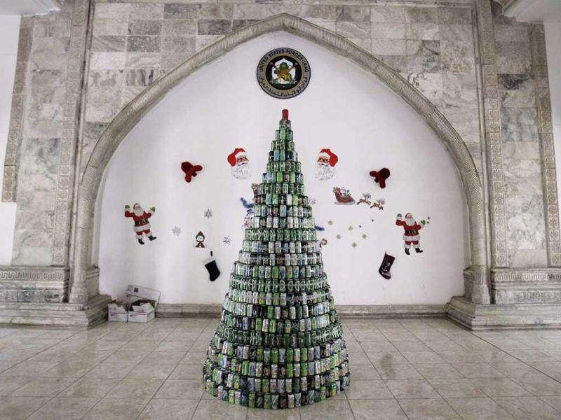 A Christmas tree made of cans is seen inside the administration building for the Office of Security Operation-Iraq (OSCI), and the former headquarters of Iraq's political Ba'ath Party, in Baghdad, Iraq. (Reuters/Shannon Stapleton)