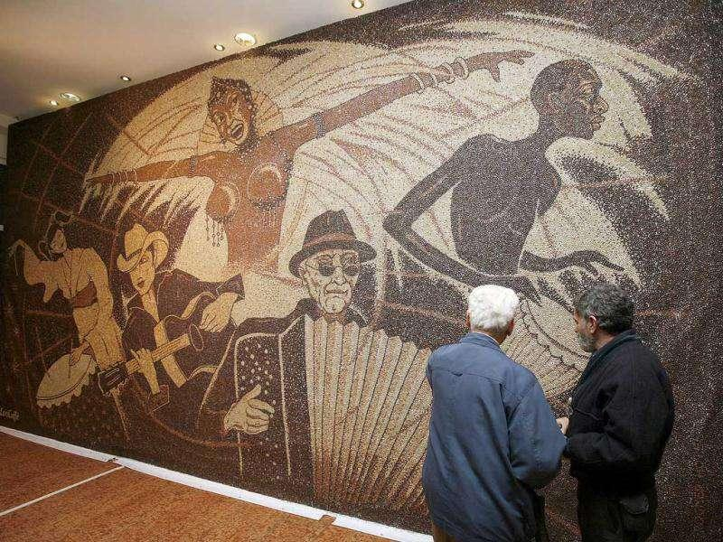 People look at a coffee bean mosaic by Albanian artist Saimir Strati in Tirana. (Reuters/Arben Celi)