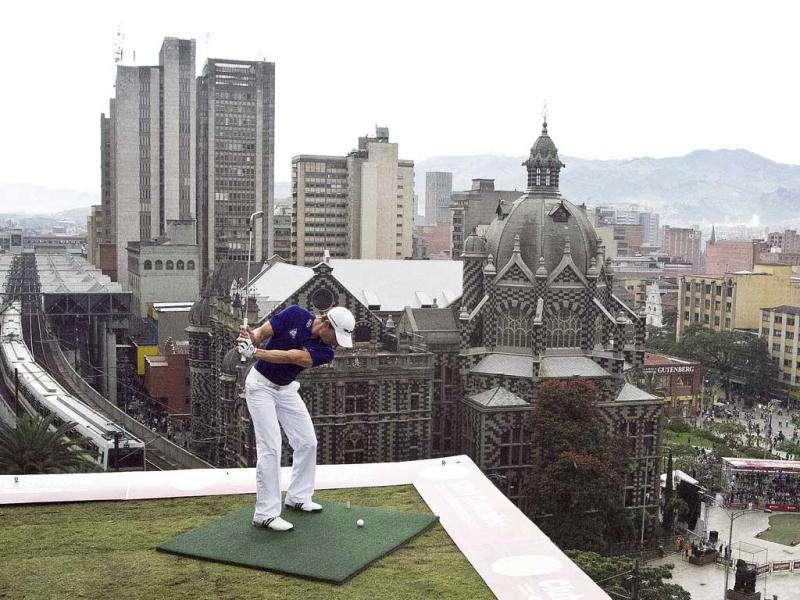 Camilo Villegas of Colombia attempts a hole-in-one in La Plaza Botero (Botero square) from the tenth floor of a hotel during the