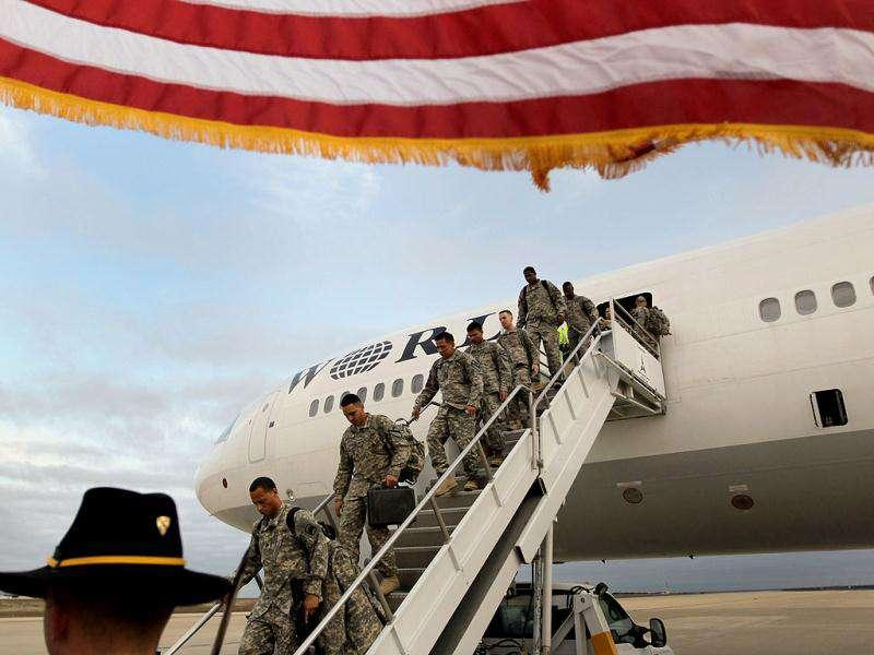 US Army soldiers from the 2-82 Field Artillery, 3rd Brigade, 1st Cavalry Division, walk off the plane as they arrive at their home base of Fort Hood, Texas after being part of one of the last American combat units to exit from Iraq in Fort Hood, Texas. The US military formally ended its mission in Iraq after eight years of war and the overthrow of Saddam Hussein.