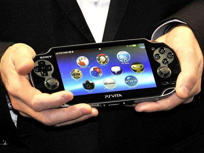 Japan's video game giant Sony Compuer Entertainment (SCE) president Andrew House displays the new portable video game console