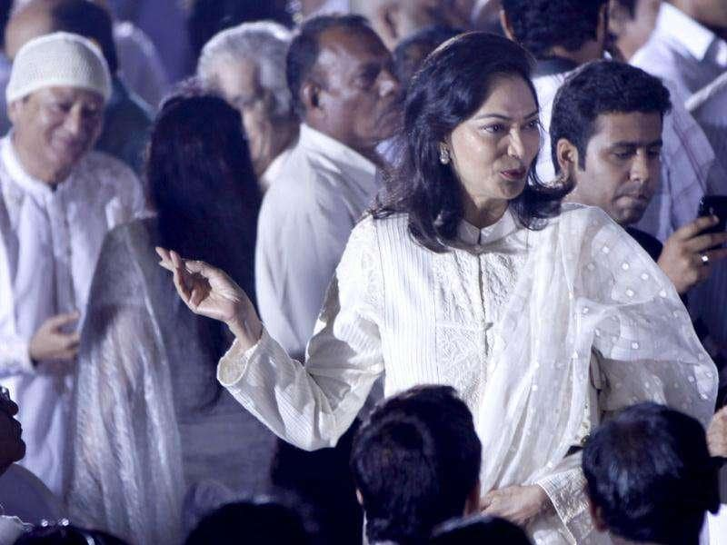 Bollywood star Simi Garewal greets people during a memorial service for legend Dev Anand in Mumbai on Friday. (HT Photo/Sattish Bate)