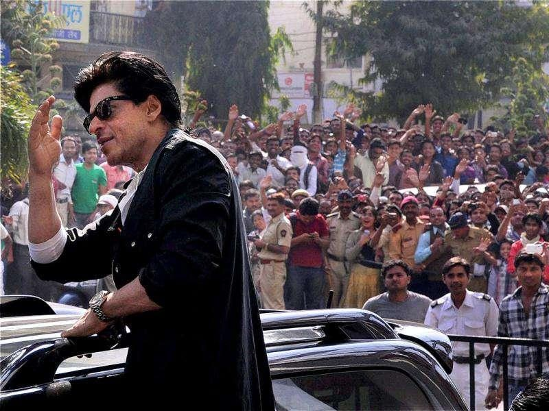 Actor Shah Rukh Khan gestures towards a group of his fans during a promotional event for his upcoming film Don 2 in Nagpur. (PTI)