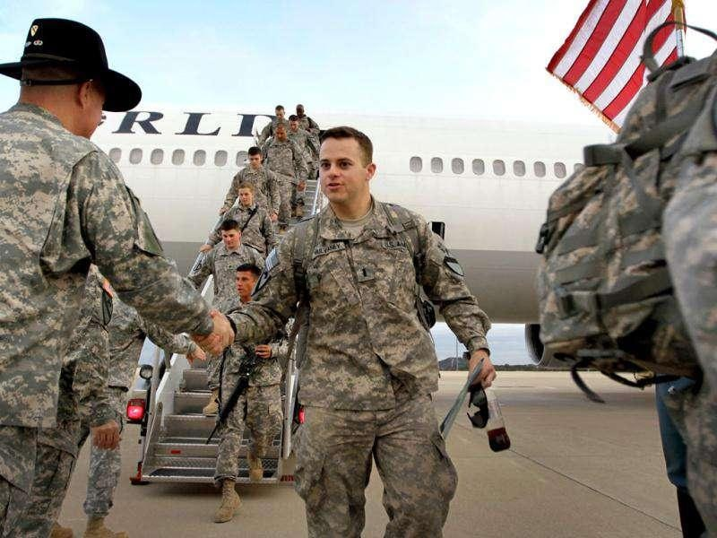 US Army Lieutenant Patrick Mulvaney from Sugar Land, Texas, of the 2-82 Field Artillery, 3rd Brigade, 1st Cavalry Division, is greeted as he walks off the plane as they arrive at their home base of Fort Hood, Texas after being part of one of the last American combat units to exit from Iraq in Fort Hood, Texas.