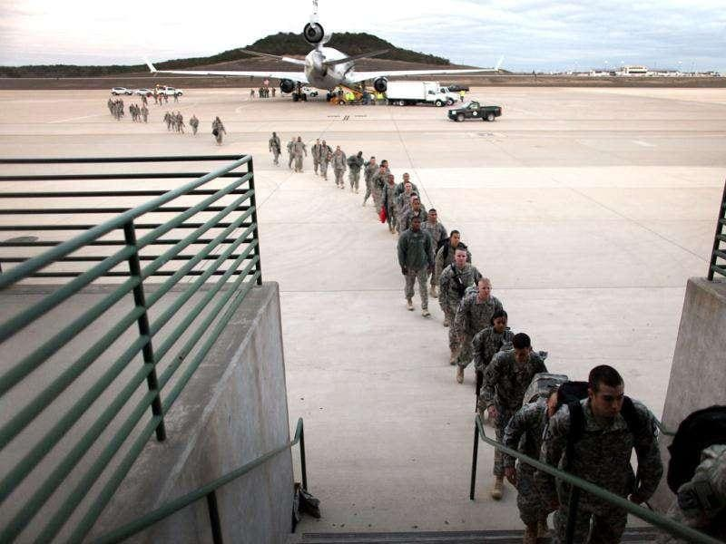 US Army soldiers from the 2-82 Field Artillery, 3rd Brigade, 1st Cavalry Division, walk off the plane as they arrive at their home base of Fort Hood, Texas after being part of one of the last American combat units to exit from Iraq in Fort Hood, Texas.