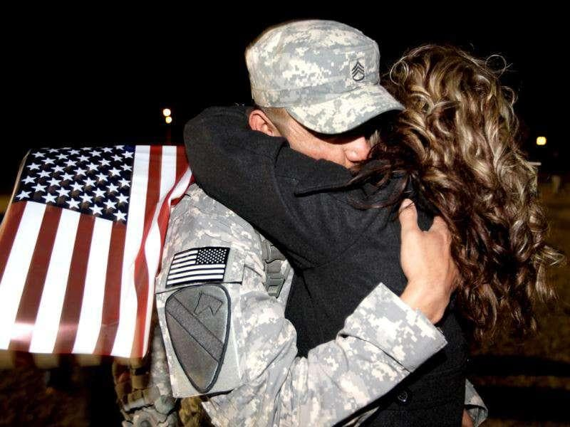 US Army Staff Sergeant Myles James from the 2-82 Field Artillery, 3rd Brigade, 1st Cavalry Division, is greeted as he arrives at the home base of Fort Hood, Texas after being part of one of the last American combat units to exit from Iraq in Fort Hood, Texas.