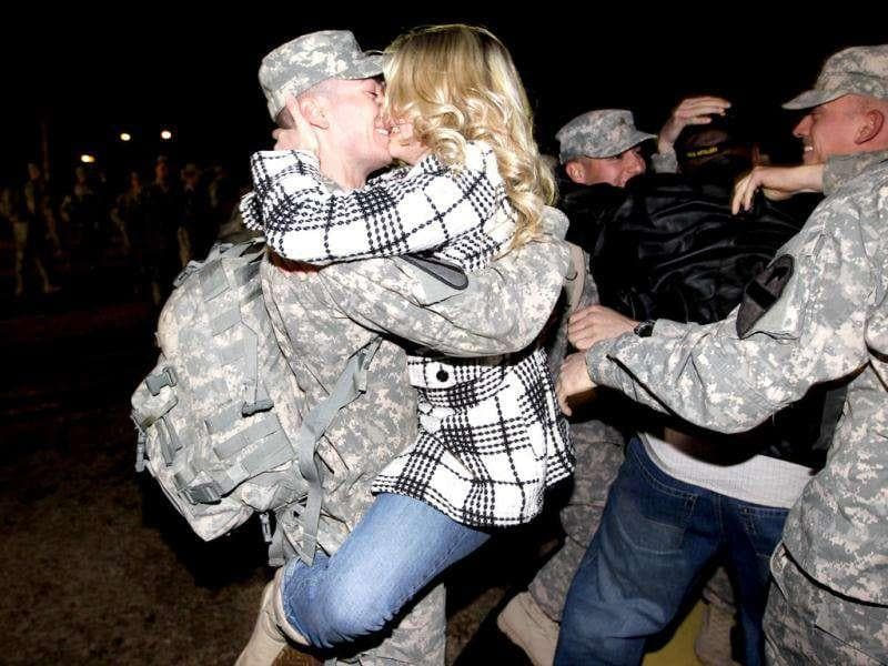 US Army Staff Sergeant Chad Johnson from the 2-82 Field Artillery, 3rd Brigade, 1st Cavalry Division, is greeted as he arrives at the home base of Fort Hood, Texas after being part of one of the last American combat units to exit from Iraq in Fort Hood, Texas.