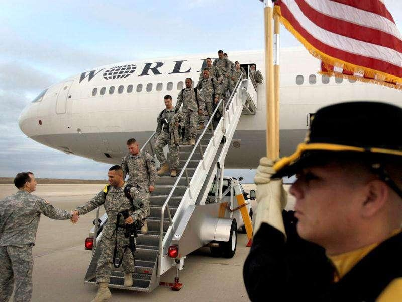 US Army soldiers from the 2-82 Field Artillery, 3rd Brigade, 1st Cavalry Division, walk off the plane as they arrive at their home base of Fort Hood, Texas after being part of one of the last American combat units to exit from Iraq.