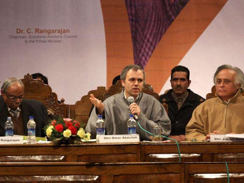Omar Abdullah with Jairam Ramesh and C Rangarajan, chairman, economic advisory council to Prime Minister during a function held in connection with the distribution of appointment letters under Himayat project launched to provide skill development training to the unemployed youth of Jammu and Kashmir in Srinagar. HT Photo/Waseem Andrabi