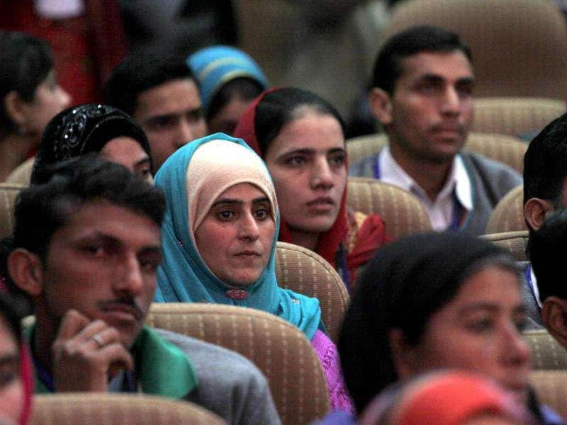 Students listening to Omar Abdullah during a function held in connection with the distribution of appointment letters under Himayat project launched to provide skill development training to the unemployed youth of Jammu and Kashmir in Srinagar. HT Photo/Waseem Andrabi