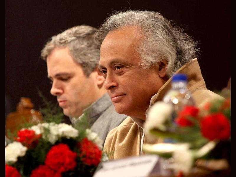 Jairam Ramesh and Omar Abdullah shares stage with during a function held in connection with the distribution of appointment letters under Himayat project launched to provide skill development training to the unemployed youth of Jammu and Kashmir in Srinagar. HT Photo/Waseem Andrabi