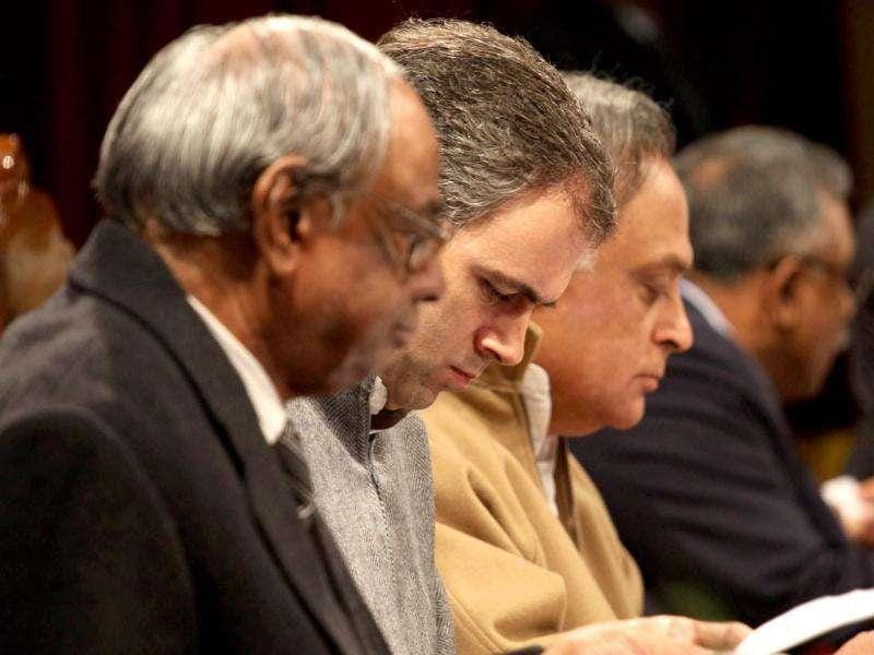 Omar Abdullah, Jairam Ramesh and C Rangarajan, chairman, economic advisory council to Prime Minister during a function held in connection with the distribution of appointment letters under Himayat project launched to provide skill development training to the unemployed youth of Jammu and Kashmir in Srinagar. HT Photo/Waseem Andrabi