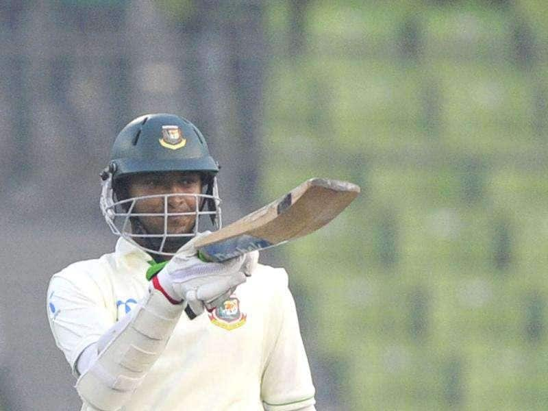 Bangladeshi batsman Shakib Al Hasan acknowledges the crowd after scoring a century (100 runs) during the first day of the second cricket Test match between Bangladesh and Pakistan at the Sher-e-Bangla National Cricket Stadium in Dhaka. AFP Photo/Munir uz Zaman