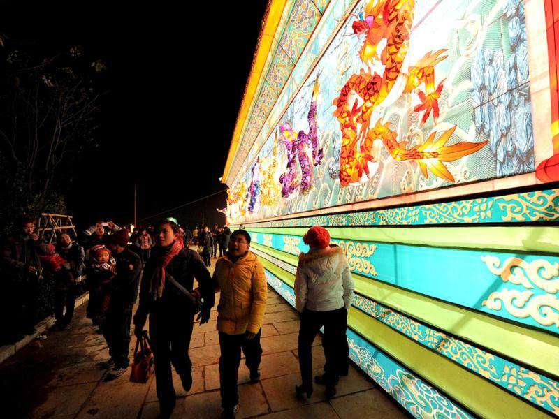 Visitors admire the giant lanterns on display at the International Lantern Festival in Hefei, east China's Anhui province. The International Lantern Festival showcases thousands of lanterns to attract tourists ahead of the Spring Festival or better known as the Chinese New Year on January 22, 2012.