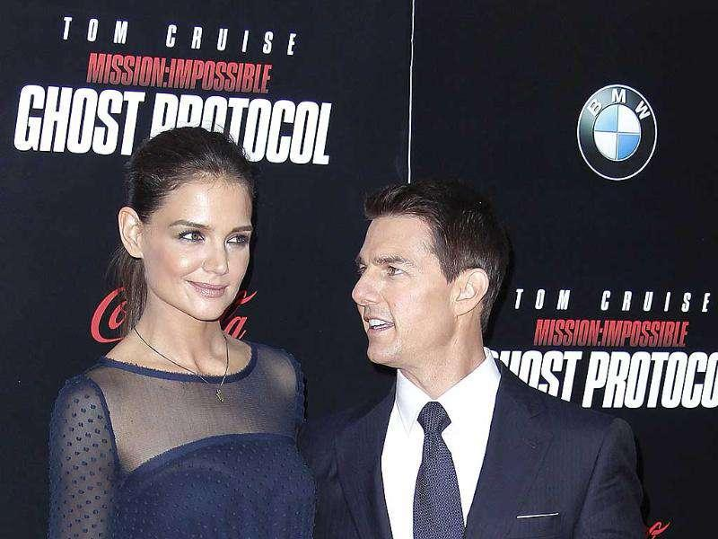 Cast member Cast member Tom Cruise and wife Katie Holmes arrive for the premiere of the film Mission: Impossible - Ghost Protocol in New York. arrive for the premiere of the film Mission: Impossible - Ghost Protocol in New York.