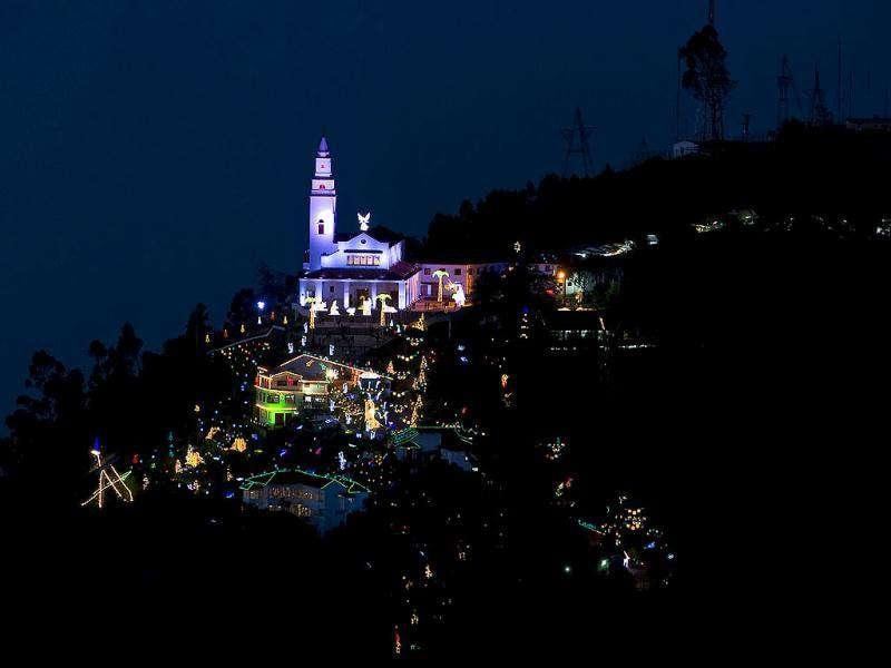 Photo taken from Guadalupe Mountain of the sanctuary Basilica of the Fallen Lord of Montserrate, decorated with Christmas lights, at the Monserrate hill, in Bogota.
