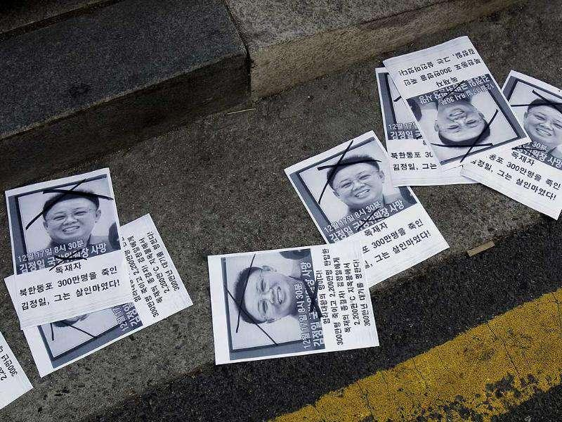 Leaflets denouncing Kim Jong Il lay in the gutter during a protest a day after Kim's death was announced in front of the Government Complex in Seoul, South Korea.