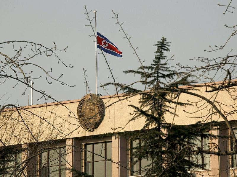 A North Korean national flag flutters at half-mast at North Korean embassy in Beijing, China. Kim Jong Il, North Korea's mercurial and enigmatic longtime leader has died, North Korean state media announced on Dec 19.