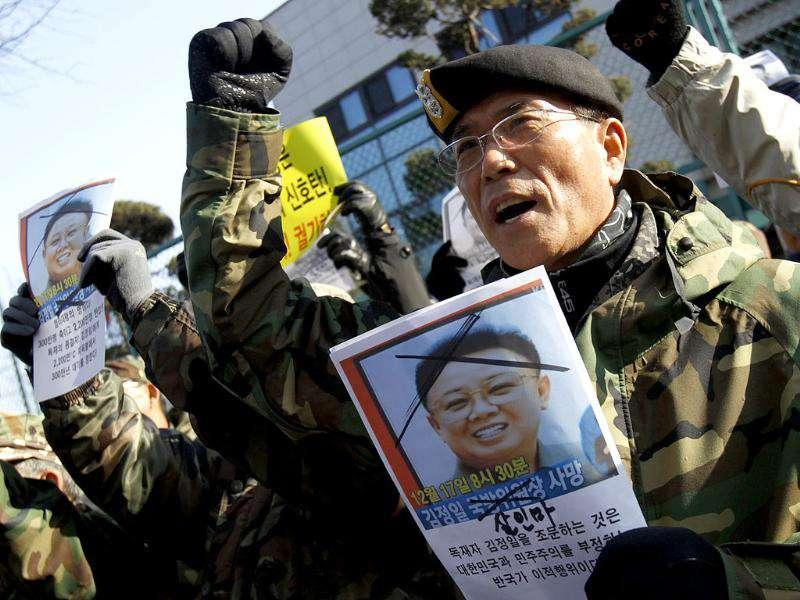 South Korean veterans chant slogans during an anti-North Korea protest in Seoul. About 30 retired soldiers demanded South Korean government not to allow any condolence call from South Korea for deceased North Korean leader Kim Jong-Il.