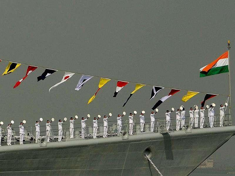 Sailors stand on the deck of INS Mumbai during a the Fleet Review (PFR-11) in Mumbai.