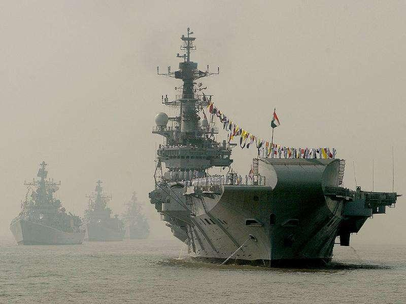 Indian Navy's aircraft carrier INS Viraat is seen with other ships during a the Fleet Review (PFR-11) in Mumbai.
