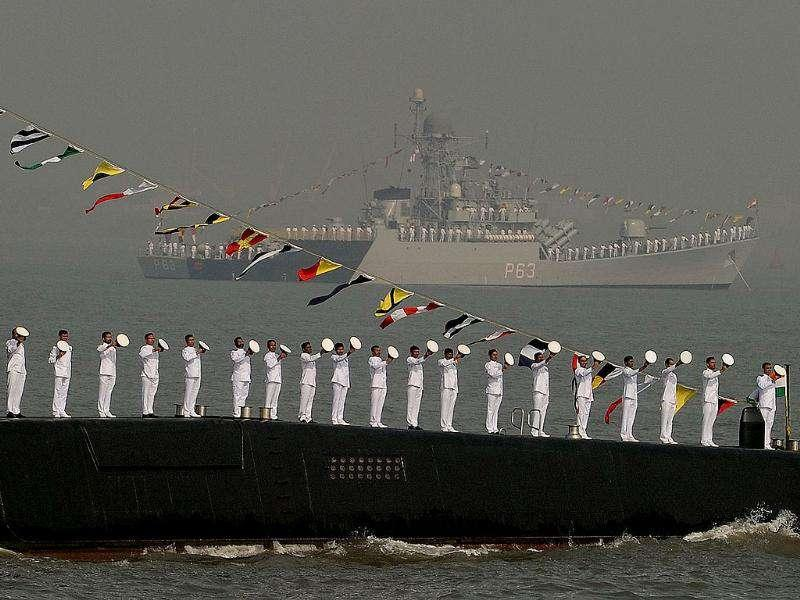 Sailors stand on the deck of a submarine during a Fleet Review (PFR-11) in Mumbai.