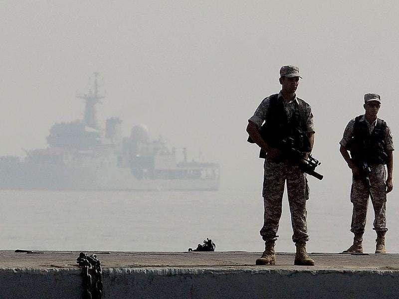 Indian Navy's commandos stand guard during a the Fleet Review (PFR-11) in Mumbai.