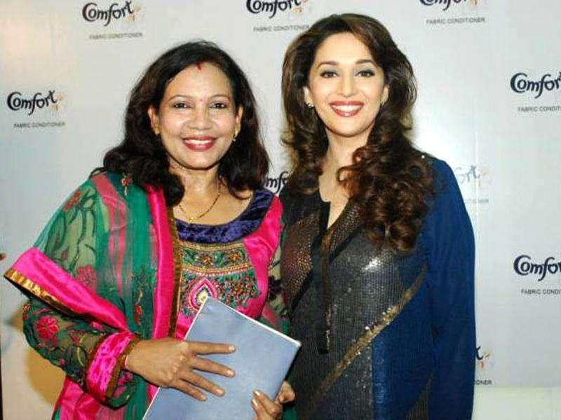Madhuri Dixit poses with the winner.