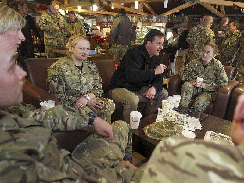 British Prime Minister David Cameron (C) meets with British soldiers at Kandahar airfield, Afghanistan. Cameron paid a pre-Christmas visit to British troops in Afghanistan. AP/Jeff J. Mitchell, Pool