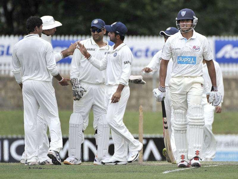 India celebrate the wicket of Usman Khawaja on the second day of the cricket match between Australian Chairmans XI and India at Manuka Oval in Canberra. AFP Photo