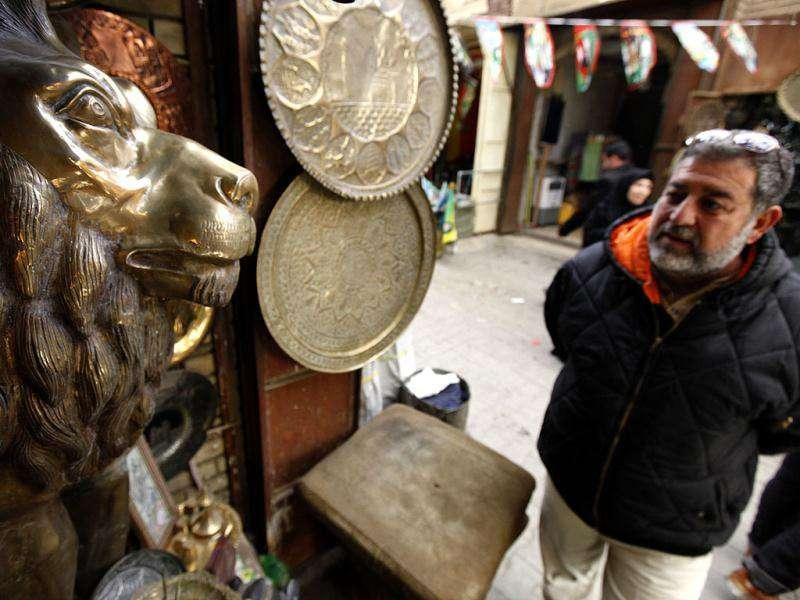 A man shops for antiques in Baghdad's al-Safafeer Souq bazaar. Al-Safafeer Souq is one of the capital's street market that sells traditional and cultural goods ranging from souvenir items to antiques. (Reuters)
