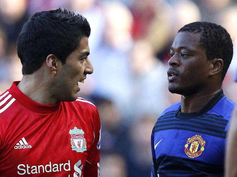 Liverpool's Luis Suarez (L) and Manchester United's Patrice Evra look at each other during their English Premier League soccer match at Anfield in Liverpool, northern England. (Reuters)