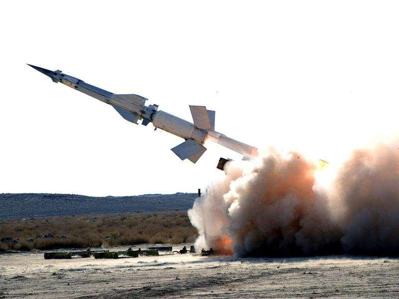 A missile is launched during a Syrian armed forces live firing exercise in an undisclosed location in this handout photograph released by Syria's national news agency SANA. (Reuters)