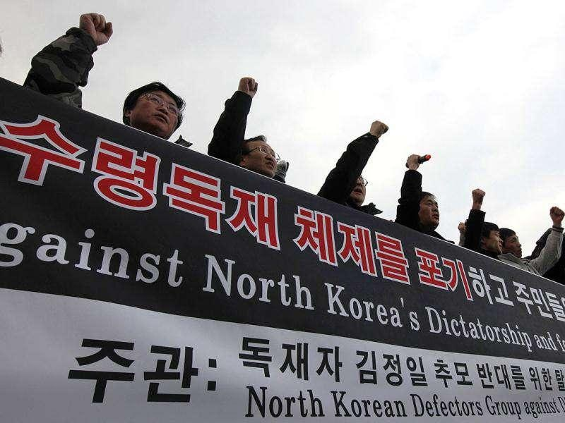 North Korean defectors who live in South Korea shout slogans and hold a banner before releasing balloons carrying anti-North Korea leaflets at the Imjinkak pavilion, near the demilitarized zone which separates the two Koreas in Paju, about 50 km north of Seoul. The defector groups who released 200,000 anti-North Korea leaflets, celebrated the death of North Korean leader Kim Jong-il and protested against condolences to the dictator's death. Reuters/Kim Kyung-Hoon
