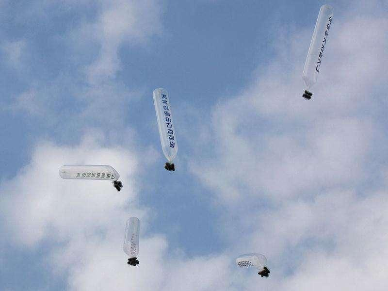 Balloons carrying anti-North Korea leaflets which are released by North Korean defectors who live in South Korea, fly in the sky at the Imjinkak pavilion, near the demilitarized zone which separates the two Koreas in Paju, about 50 km north of Seoul. The slogans on the balloons read (L-R)