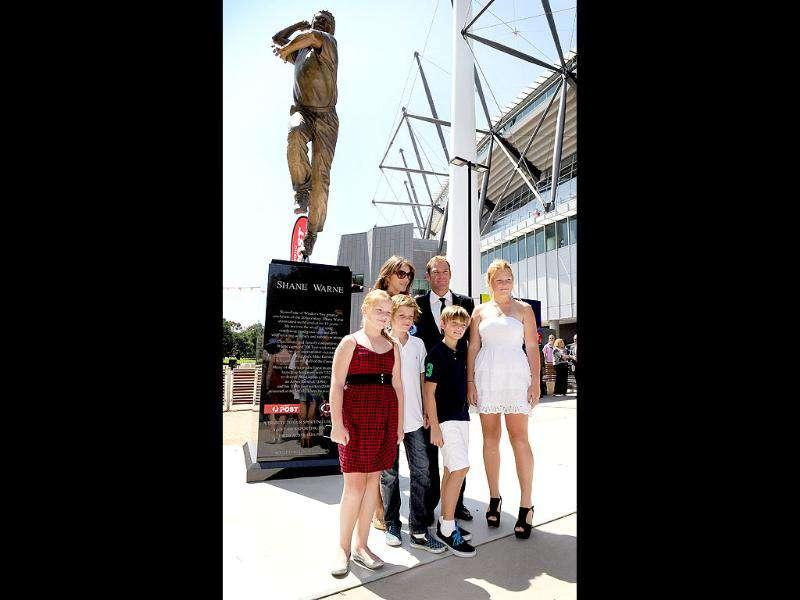 Australian cricketer Shane Warne (R rear) and fiancee Liz Hurley (L rear) stand with Warne's children Summer (L), Jackson (2/L), Brooke (R) and Hurley's son Damien (2/R) at the unveiling of a statue of Warne outside the Melbourne Cricket Ground, in Melbourne.