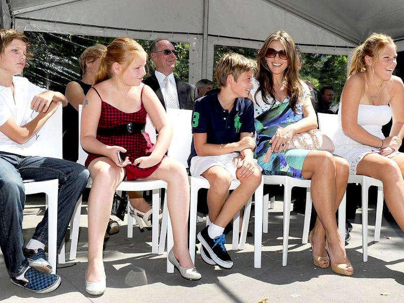 Australian cricketer Shane Warne's fiancee Liz Hurley (2/R) sits with his children Jackson (L), Summer (2/L), Brooke (R) and her son Damien (C) during the unveiling of Warne's statue outside the Melbourne Cricket Ground, in Melbourne.