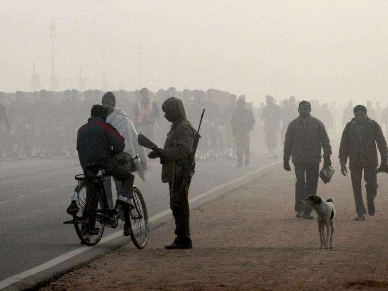 Soldiers take part in a rehearsal on Rajpath for next month's Republic Day, on a cold and foggy morning in New Delhi