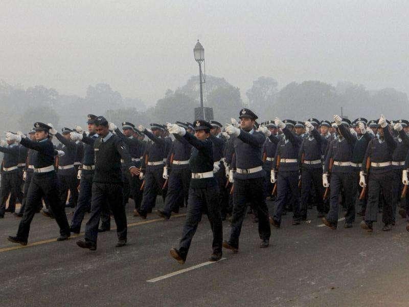 Soldiers take part in a rehearsal on Rajpath for next month's Republic Day, on a cold and foggy morning in New Delhi.