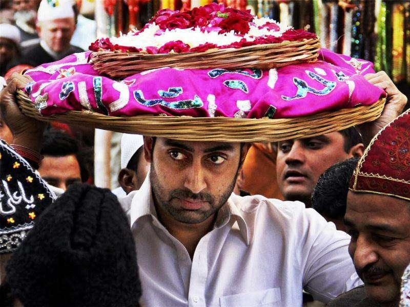 Abhishek carrying a holy 'chadar' to offer it at the shrine of Khwaja Moinuddin Chishti (PTI Photo)
