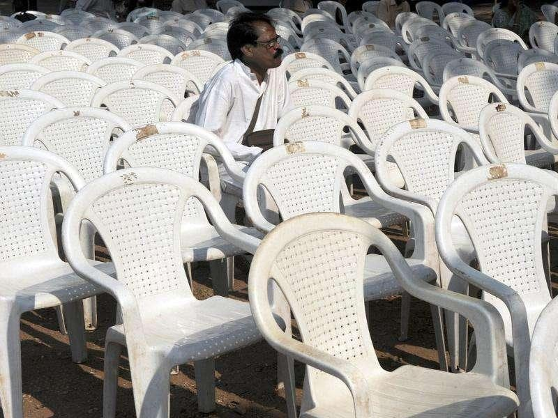 A protestor sits amidst empty chairs during a protest rally against the people opposing the proposed law to create a powerful new ombudsman, Lokpal Bill, in Mumbai. AFP Photo