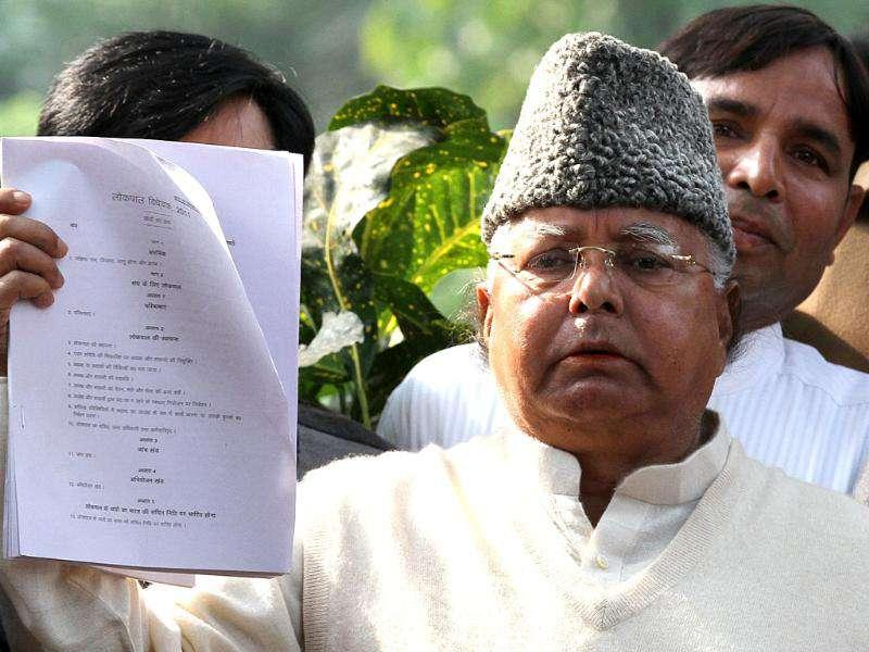 RJD chief Lalu Prasad Yadav shows a copy of the Lokpal Bill at Parliament House in New Delhi. HT Photo/Arvind Yadav