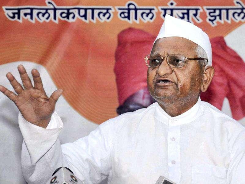 Anna Hazare addresses a press conference in Ralegan Siddhi, Ahmednagar following the introduction of Lokpal Bill in Lok Sabha. PTI Photo
