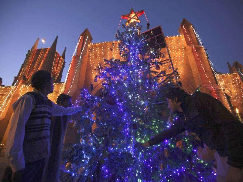 Pakistani Christians make final adjustments to decorations on a Christmas tree at St John's Cathedral, during preparations for Christmas celebrations in Peshawar, Pakistan. AP Photo