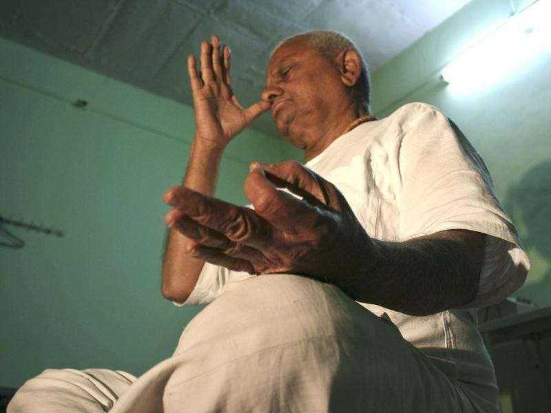 Anti-corruption activist Anna Hazare, who has been ramping up pressure on the government to bring sweeping legislation to end corruption, performs yoga in his village Ralegan Siddhi. AP Photo
