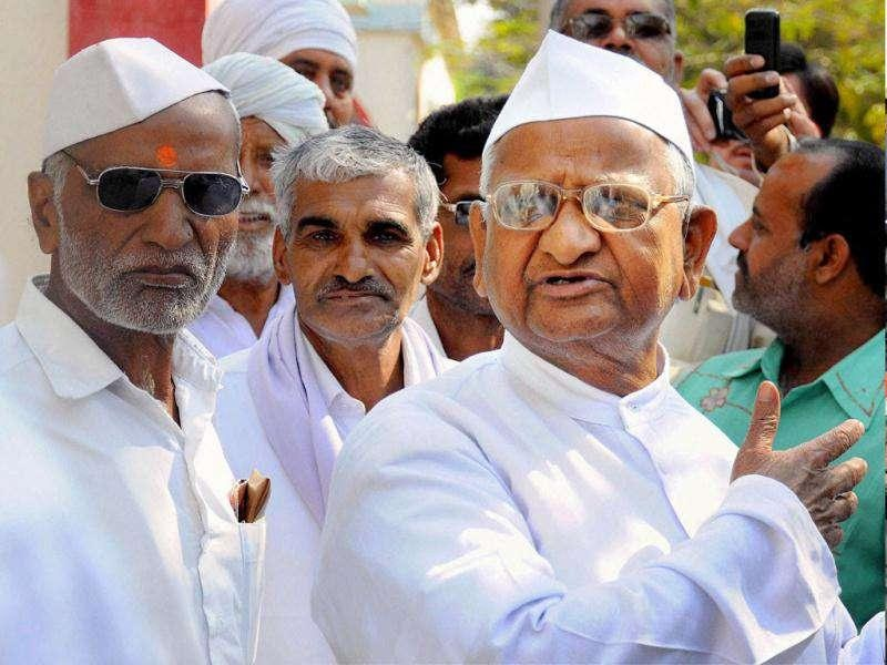 Anti-corruption activist Anna Hazare talks to his supporters in Ralegan Siddhi, Ahmednagar following the introduction of Lokpal Bill in Lok Sabha. PTI Photo